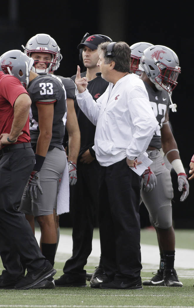 Washington State head coach Mike Leach, center, speaks to his team during the second half of an NCAA college football game against Oregon State in Pullman, Wash., Saturday, Sept. 16, 2017. (AP Pho ...