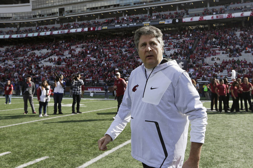 Washington State head coach Mike Leach walks on the field before an NCAA college football game against Nevada in Pullman, Wash., Saturday, Sept. 23, 2017. (AP Photo/Young Kwak)