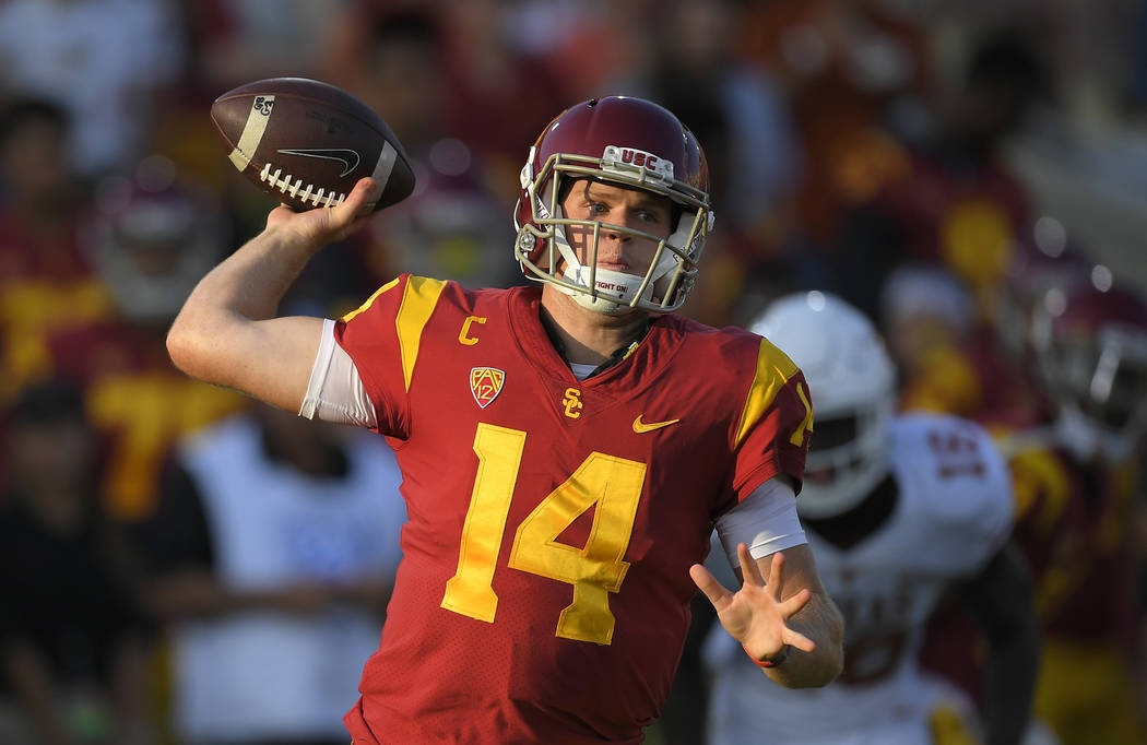 FILE - In this Saturday, Sept. 16, 2017, file photo, Southern California quarterback Sam Darnold throws during the first half of an NCAA college football game against Texas, in Los Angeles. Darnol ...