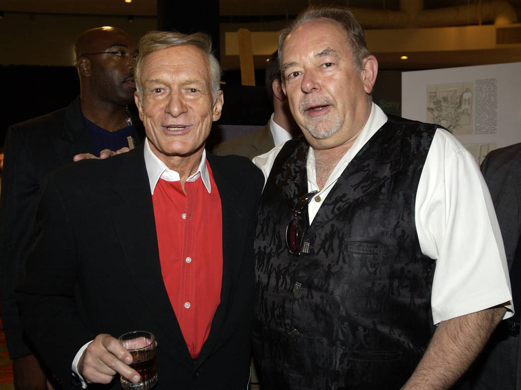Robin Leach and Hugh Hefner at the Playboy king's 85th birthday party in Las Vegas. Hefner died at 91 on Sept. 27.  (Denise Truscello)