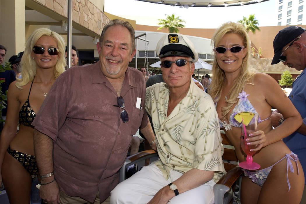 Robin Leach poses with Hugh Hefner alongside Holly Madison (left) and Bridget Marquardt (right). (Courtesy Alex Acuna/Palms)