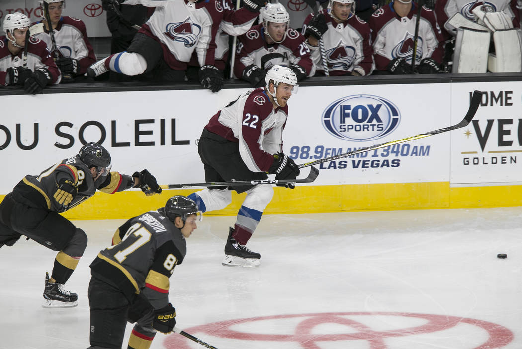 Colorado Avalanche center Colin Wilson (22) breaks away from Vegas Golden Knights center Jonathan Marchessault (81) and center Vadim Shipachyov (87) during the first period of a preseason NHL hock ...