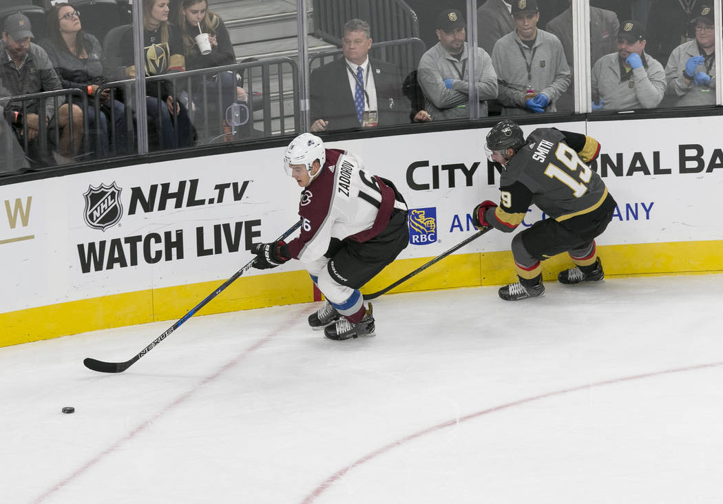 Colorado Avalanche defenseman Nikita Zadorov (16) is chased by Vegas Golden Knights right wing Reilly Smith (19) during the first period of a preseason NHL hockey game between the Vegas Golden Kni ...