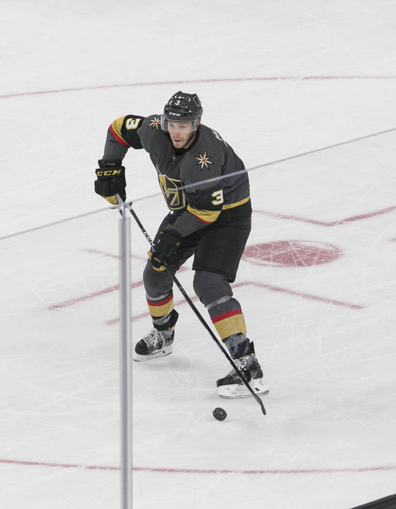 Vegas Golden Knights defenseman Brayden McNabb (3) controls the puck during the first period of a preseason NHL hockey game between the Vegas Golden Knights and the Colorado Avalanche on Thursday, ...