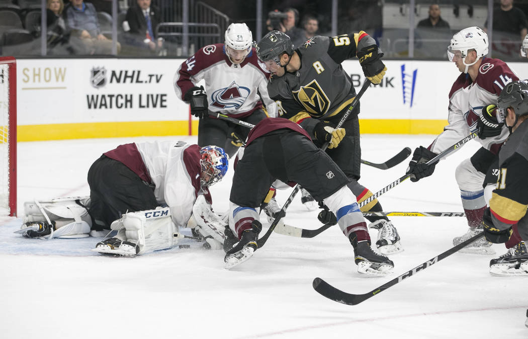 Colorado Avalanche goalie Semyon Varlamov (1) blocks a shot from Vegas Golden Knights left wing David Perron (57) during the second period of a preseason NHL hockey game between the Vegas Golden K ...