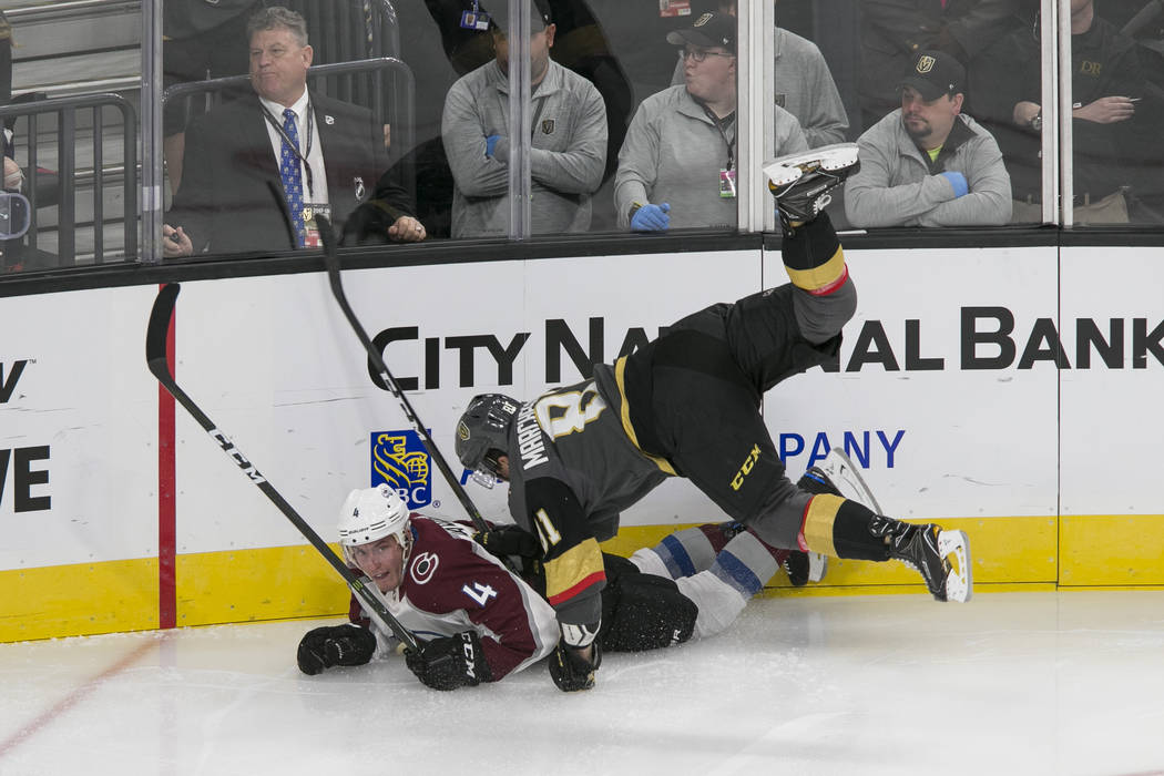 Colorado Avalanche defenseman Tyson Barrie (4) and Vegas Golden Knights center Jonathan Marchessault (81) fall to the ice during the first period of a preseason NHL hockey game between the Vegas G ...
