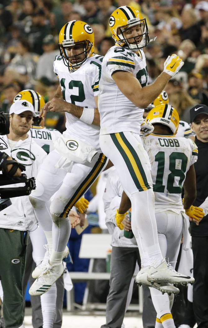 Green Bay Packers' Jordy Nelson (87) celebrates his touchdown catch with Aaron Rodgers (12) during the second half of an NFL football game against the Chicago Bears Thursday, Sept. 28, 2017, in Gr ...