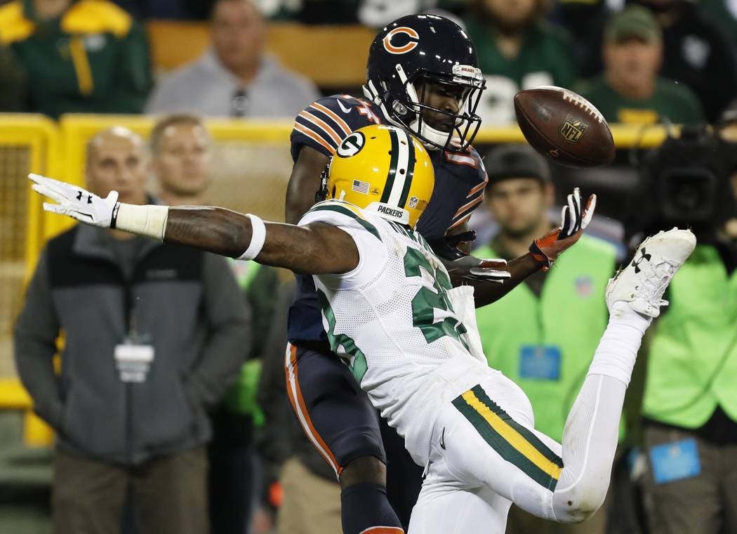 Green Bay Packers' Josh Hawkins breaks up a pass intended for Chicago Bears' Deonte Thompson during the second half of an NFL football game Thursday, Sept. 28, 2017, in Green Bay, Wis. (AP Photo/M ...