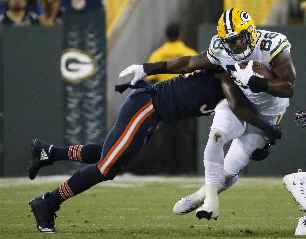 Green Bay Packers' Ty Montgomery is hit by Chicago Bears' Leonard Floyd during the first half of an NFL football game Thursday, Sept. 28, 2017, in Green Bay, Wis. (AP Photo/Mike Roemer)