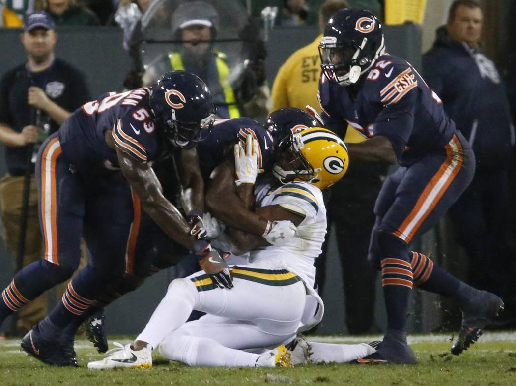 Green Bay Packers' Davante Adams goes down after being hit in the head during the second half of an NFL football game against the Chicago Bears Thursday, Sept. 28, 2017, in Green Bay, Wis. (AP Pho ...