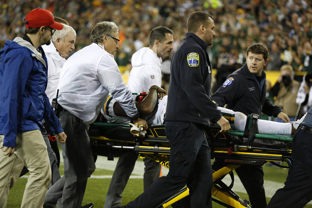 Green Bay Packers' Davante Adams is taken off the field after being hit in the head during the second half of an NFL football game against the Chicago Bears Thursday, Sept. 28, 2017, in Green Bay, ...