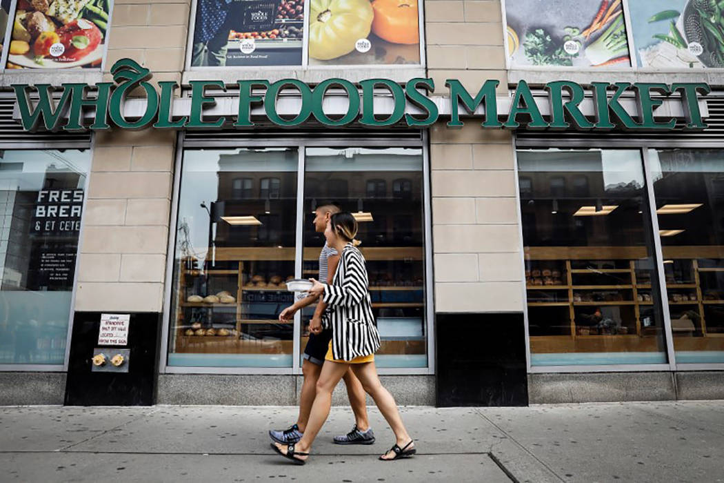 People pass by a Whole Foods store in New York in August. (REUTERS/Brendan McDermid)