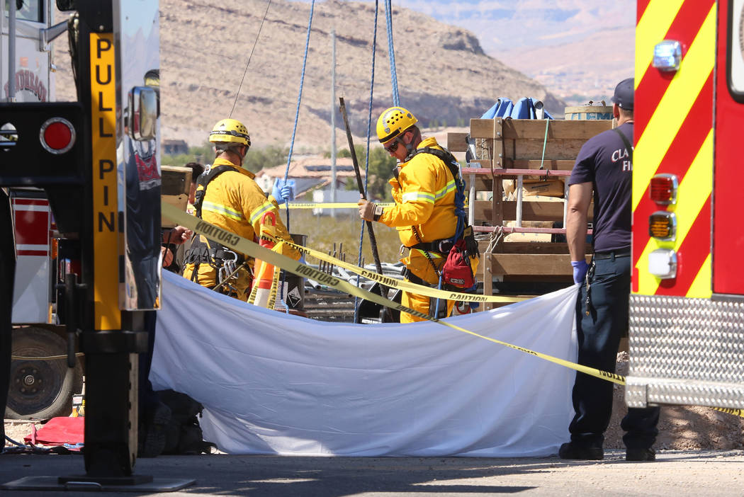 Henderson firefighters at the scene of a fatal construction accident on Jonathan Drive and Las Vegas Boulevard on Monday Sept. 25, 2017, in Las Vegas. (Bizuayehu Tesfaye/Las Vegas Review-Journal)  ...
