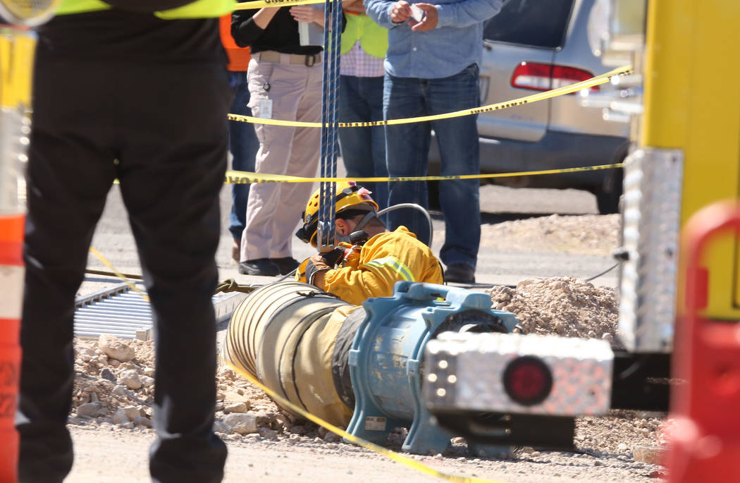 Henderson firefighter at the scene of a fatal construction accident on Jonathan Drive and Las Vegas Boulevard on Monday Sept. 25, 2017, in Las Vegas. (Bizuayehu Tesfaye/Las Vegas Review-Journal) @ ...