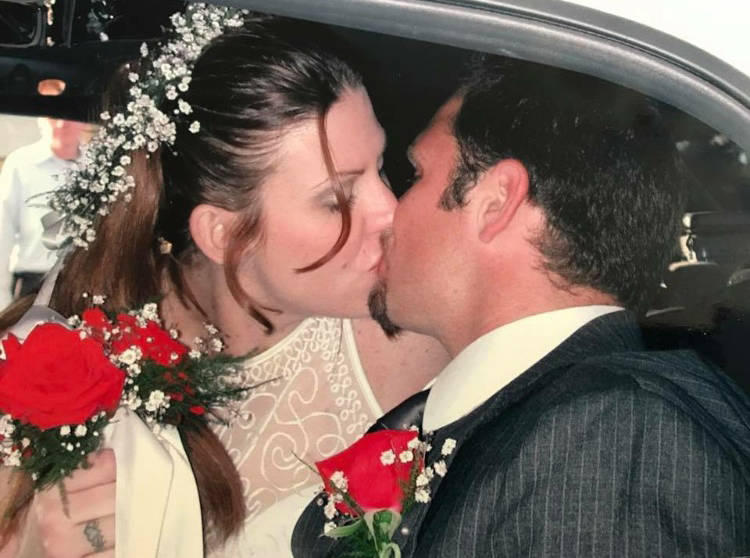 Russell Anthony Tracy and Meredith Fitzgerald-Tracy share a kiss on their wedding day in January 2002. (Tracy family)