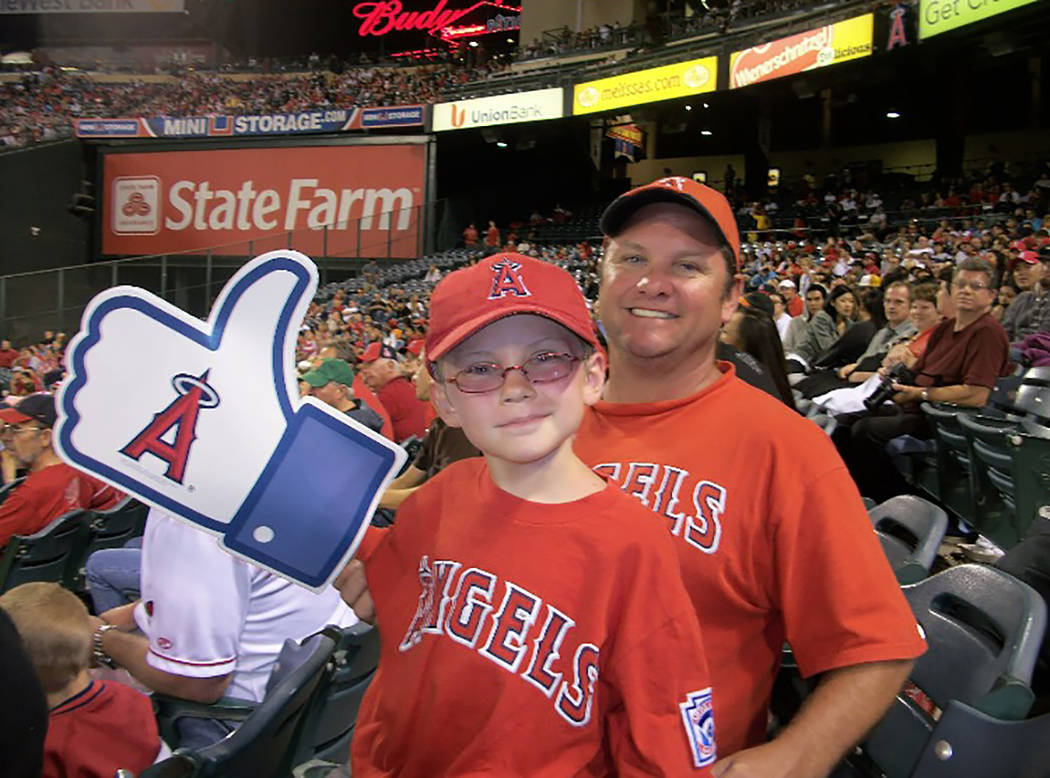 Russell Anthony Tracy watches an Angels game in California with his son, Kevin Tracy, who was 7 at the time. (Tracy family)