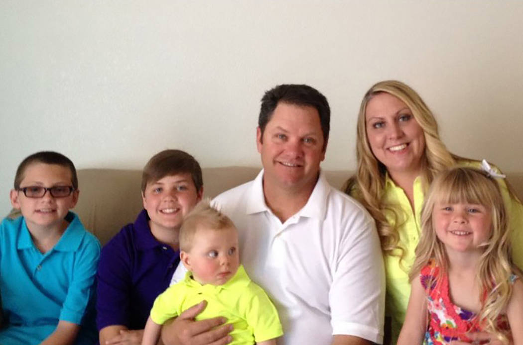 Russell Anthony Tracy and Meredith Fitzgerald-Tracy pose for a family photo with their children, Kevin Tracy, Colin Tracy, Kannon Tracy and Callie Tracy. (Tracy family)
