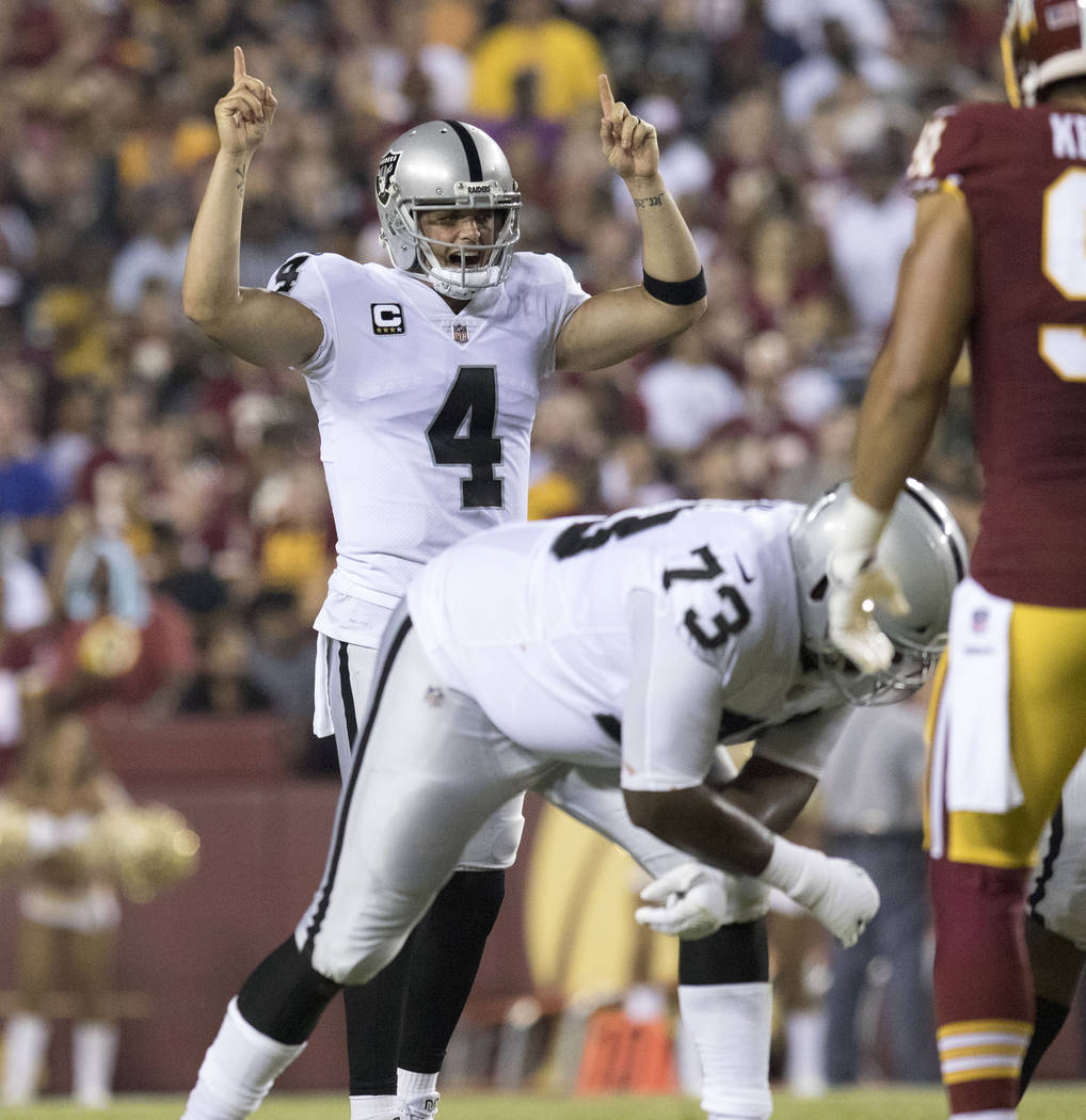 Oakland Raiders quarterback Derek Carr (4) at the line of scrimmage in the first half of their game against the Washington Redskins in Landover, Maryland, Sunday, Sept. 24, 2017. Heidi Fang Las Ve ...