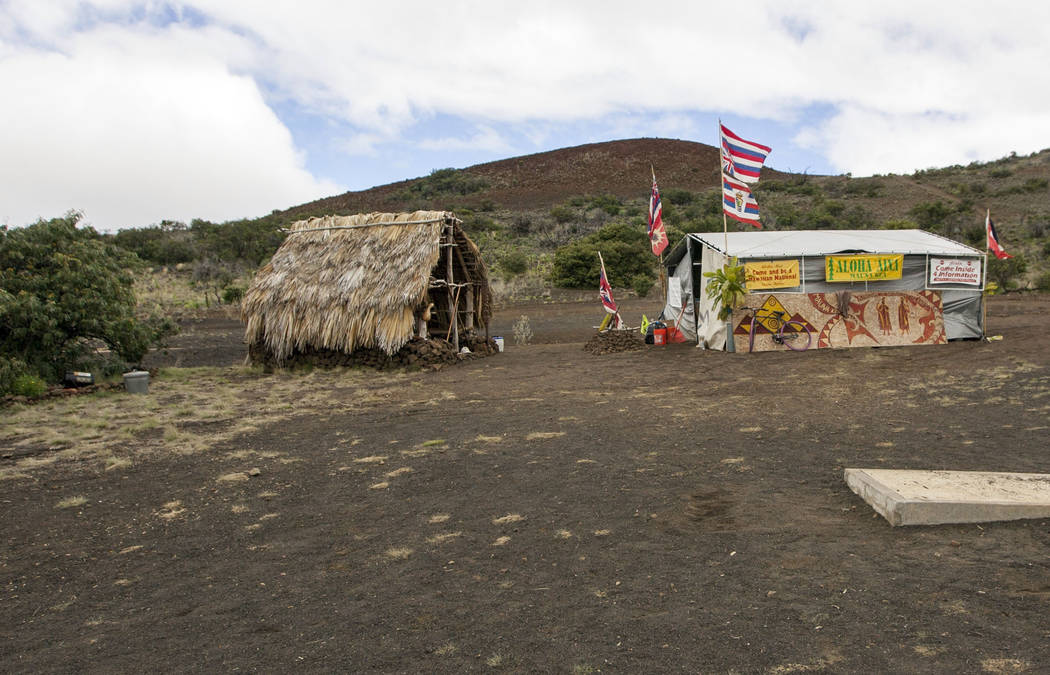 The base camp for protesters of the Thirty Meter Telescope project occupies a site near the summit of Mauna Kea on Hawaii's Big Island in 2015.  (AP Photo/Caleb Jones, File)