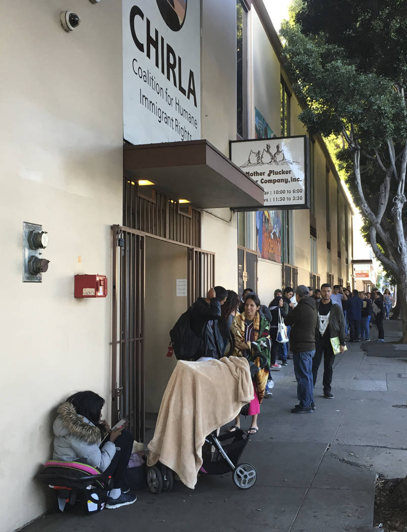 This Sept. 28, 2017 photo shows people waiting in line at CHIRLA (Coalition for Humane Immigrant Rights Los Angeles) for help with immigration paperwork, including renewing work permits for expiri ...