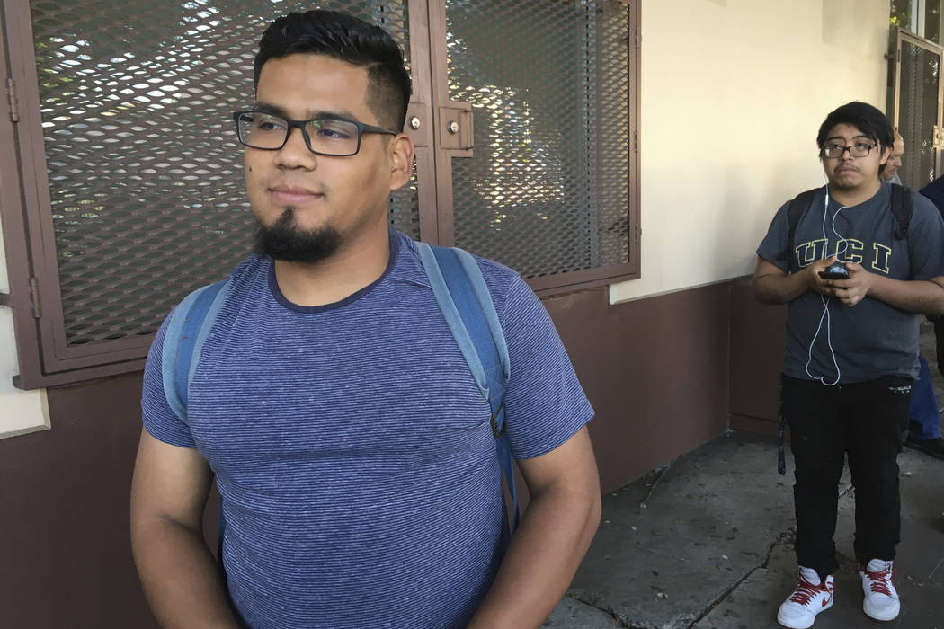 Oscar Gaytan waits in line Thursday at CHIRLA (Coalition for Humane Immigrant Rights Los Angeles) to renew his work permit under an expiring Obama-era program for immigrants brought to the country ...