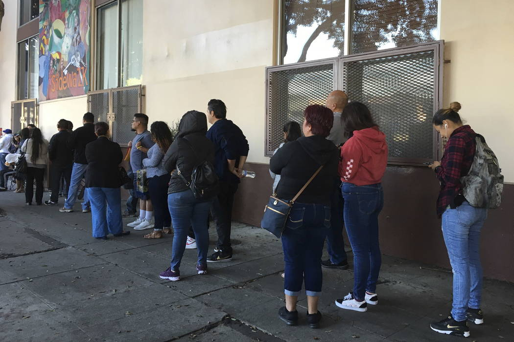 This Sept. 28, 2017 photo people wait in line at CHIRLA (Coalition for Humane Immigrant Rights Los Angeles) for help with immigration paperwork, including renewing work permits for expiring Obama- ...