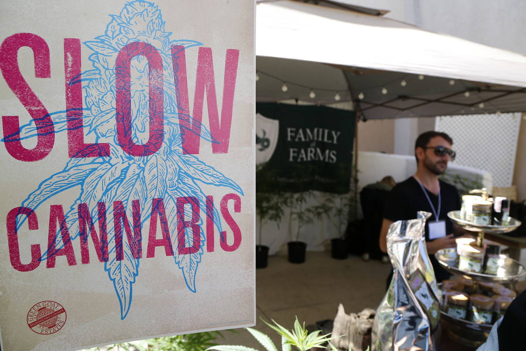 """A banner for """"Slow Cannabis"""" is displayed at the Emerald Exchange stand at """"The State of Cannabis,"""" a California industry group meeting in Long Beach, Calif., on Thursday, Sept. 28, 2017. (AP Phot ..."""