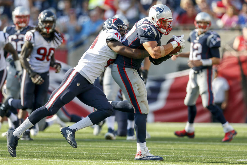Sep 24, 2017; Foxborough, MA, USA;  New England Patriots tight end Rob Gronkowski (87) is tackled by Houston Texans inside linebacker Zach Cunningham (41) during the second half at Gillette Stadiu ...