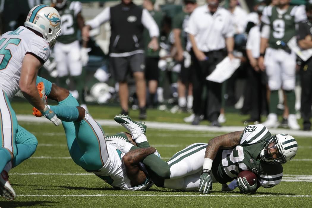 New York Jets running back Matt Forte (22) is tackled during the first half of an NFL football game against the Miami Dolphins Sunday, Sept. 24, 2017, in East Rutherford, N.J. (AP Photo/Seth Wenig)