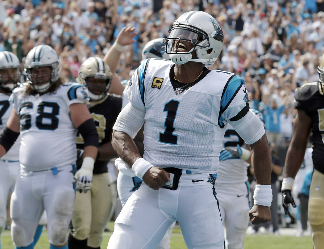 Carolina Panthers' Cam Newton (1) celebrates after running for a touchdown against the New Orleans Saints in the second half of an NFL football game in Charlotte, N.C., Sunday, Sept. 24, 2017. (AP ...