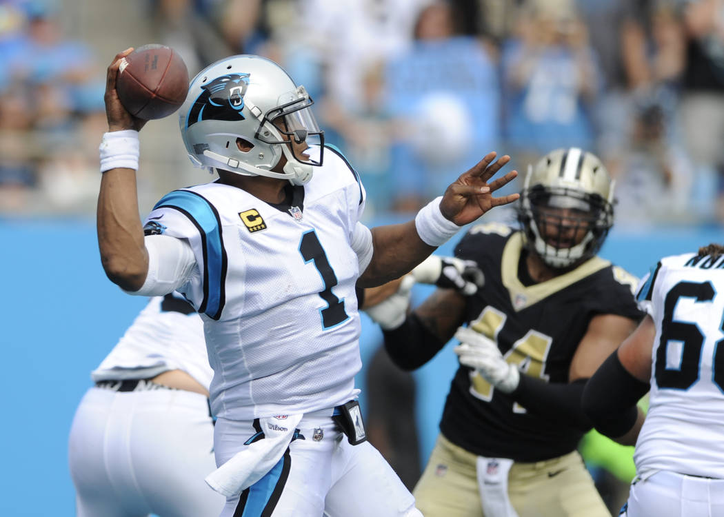 Carolina Panthers' Cam Newton (1) looks to pass against the New Orleans Saints in the second half of an NFL football game in Charlotte, N.C., Sunday, Sept. 24, 2017. (AP Photo/Mike McCarn)