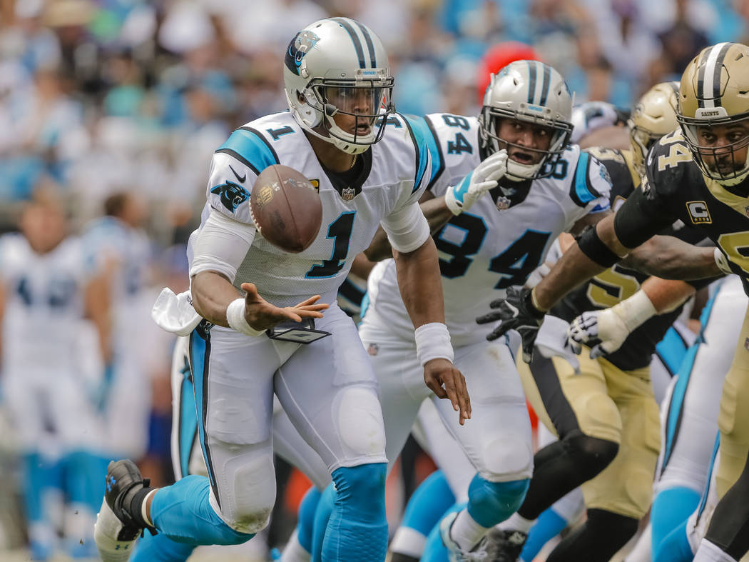 Carolina Panthers' Cam Newton (1) flips the football up for a reverse play against the New Orleans Saints during the first half of an NFL football game in Charlotte, N.C., Sunday, Sept. 24, 2017.  ...
