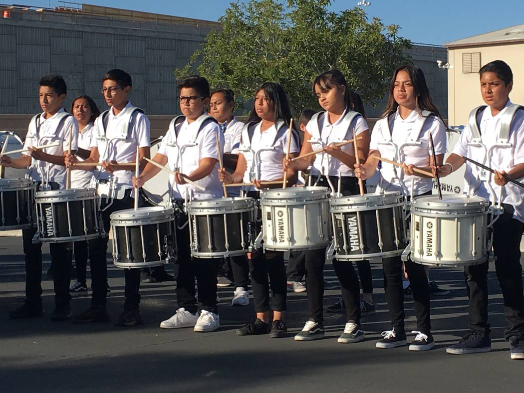 The Gibson Middle School band performs Saturday by the Las Vegas Review-Journal headquarters before the annual Walk a Mile in My Shoes walk to benefit the Las Vegas Rescue Mission. Matthew Crowley ...