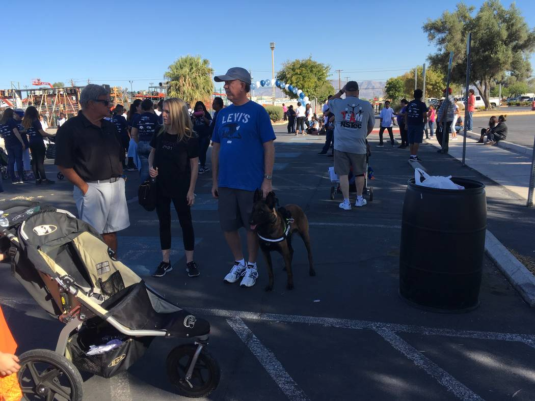 A service dog and his volunteer owner gather in the Las Vegas Review-Journal parking lot before Saturday's annual Walk a Mile in My Shoes walk to benefit the Las Vegas Rescue Mission. Matthew Crow ...