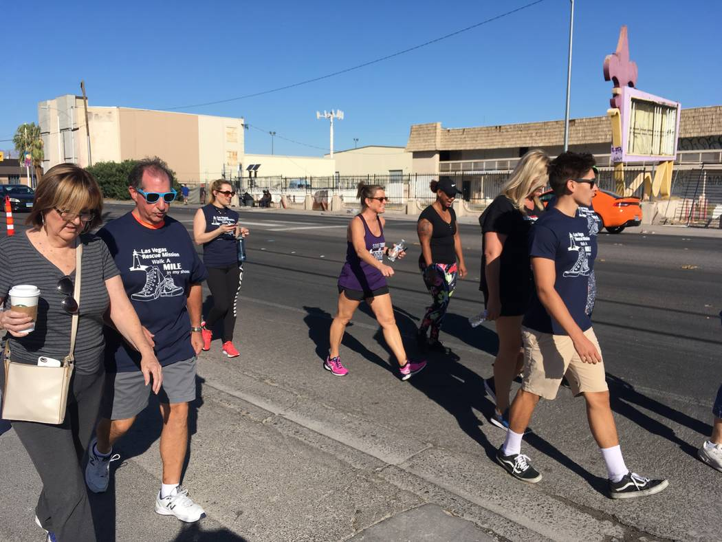 Volunteer walkers stroll down Bonanza Road on Saturday during the annual Walk a Mile in My Shoes walk to benefit the Las Vegas Rescue Mission. Matthew Crowley Las Vegas Review-Journal @copyjockey