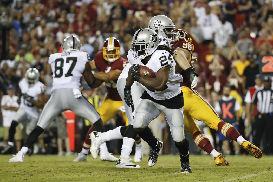Oakland Raiders running back Marshawn Lynch (24) carries the ball during the second half of an NFL football game against the Washington Redskins in Landover, Md., Sunday, Sept. 24, 2017. (AP Photo ...