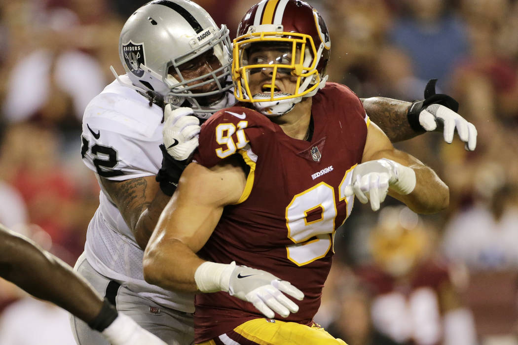 Washington Redskins outside linebacker Ryan Kerrigan (91) is blocked by Oakland Raiders offensive tackle Donald Penn (72) during an NFL football game between the Oakland Raiders and Washington Red ...