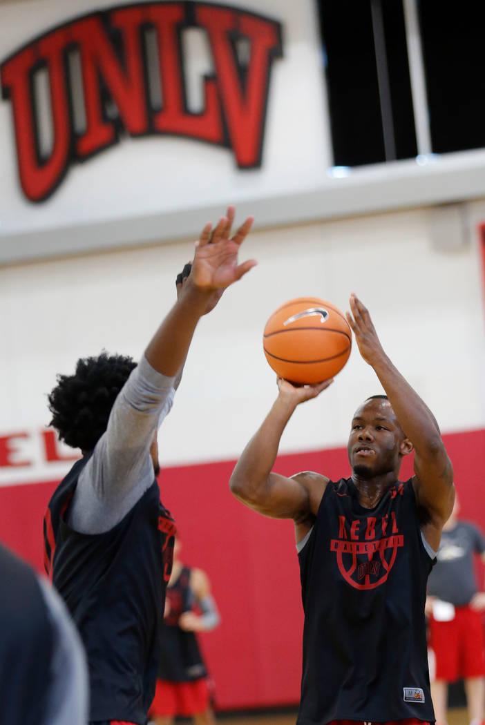 UNLV basketball player Jordan Johnson, right, shoots over his teammate Jovan Mooring during their practice at the Mendenhall Center in Las Vegas, Saturday, Sept. 30, 2017. Chitose Suzuki Las Vegas ...