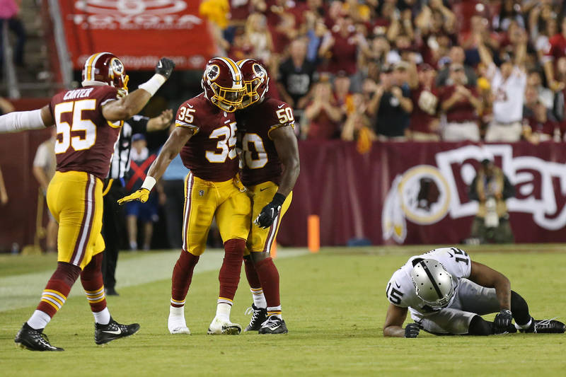 Sep 24, 2017; Landover, MD, USA; Washington Redskins strong safety Montae Nicholson (35) is congratulated by teammates after a hit on Oakland Raiders wide receiver Michael Crabtree (15) in the fou ...