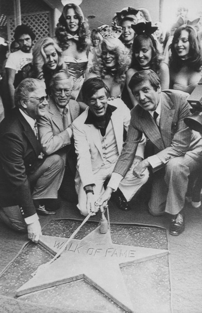 Hugh Hefner, center, receives a star on the Hollywood Walk of Fame in Los Angeles in1980. Honorary Mayor of Hollywood, Monty Hall, right, holds the rope attached to the new star with Hefner. (AP P ...