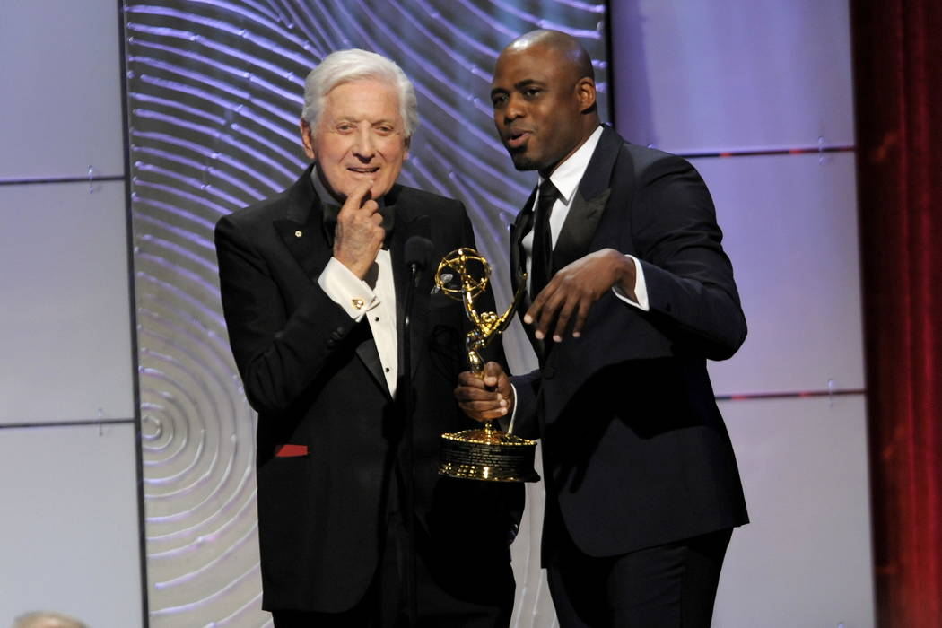 Wayne Brady, right, presents the lifetime achievement award to Monty Hall at the 40th Annual Daytime Emmy Awards in Beverly Hills, Calif., in 2013.  (Photo by Chris Pizzello/Invision/AP, File)