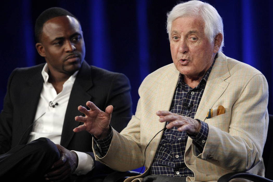 "Wayne Brady, left, looks on as television game show host Monty Hall answers a question about the new ""Let's Make A Deal"" game show at the CBS Summer Press Tour in Pasadena, Calif., in 2009.  (AP P ..."