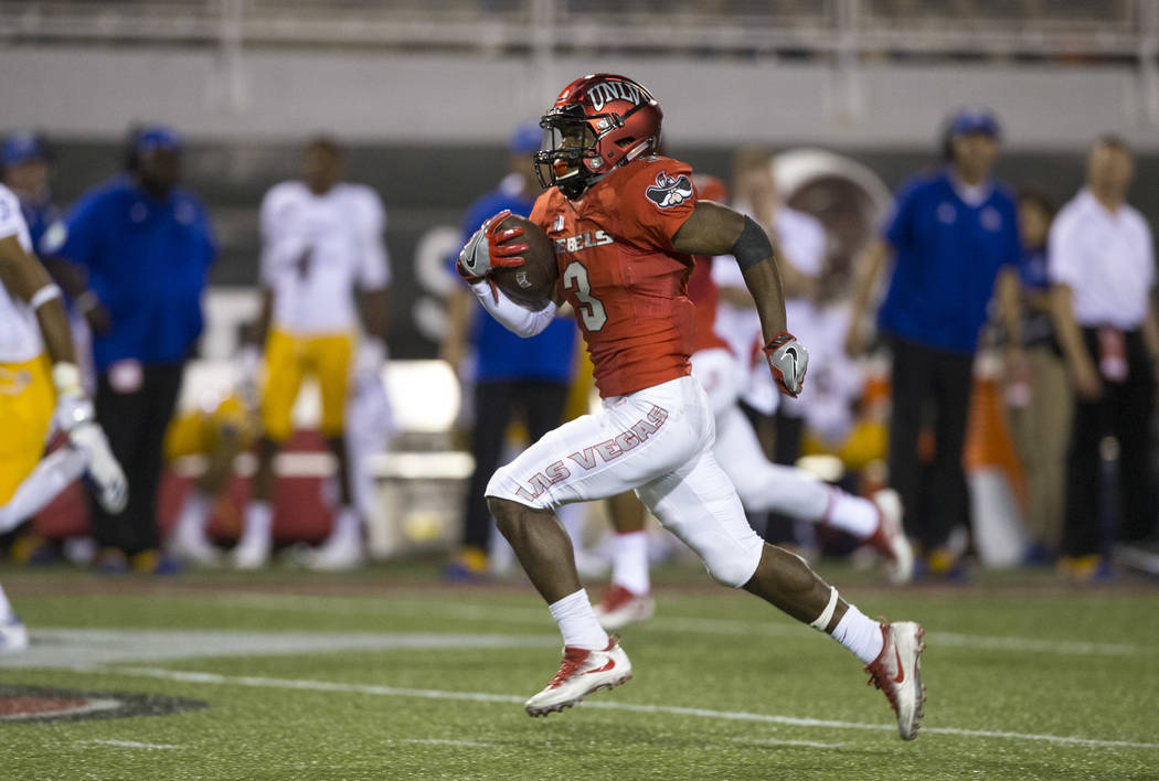 UNLV Rebels running back Lexington Thomas (3) breaks away for a touchdown during the first half of an NCAA college football game between the UNLV Rebels and the San Jose State Spartans at Sam Boyd ...
