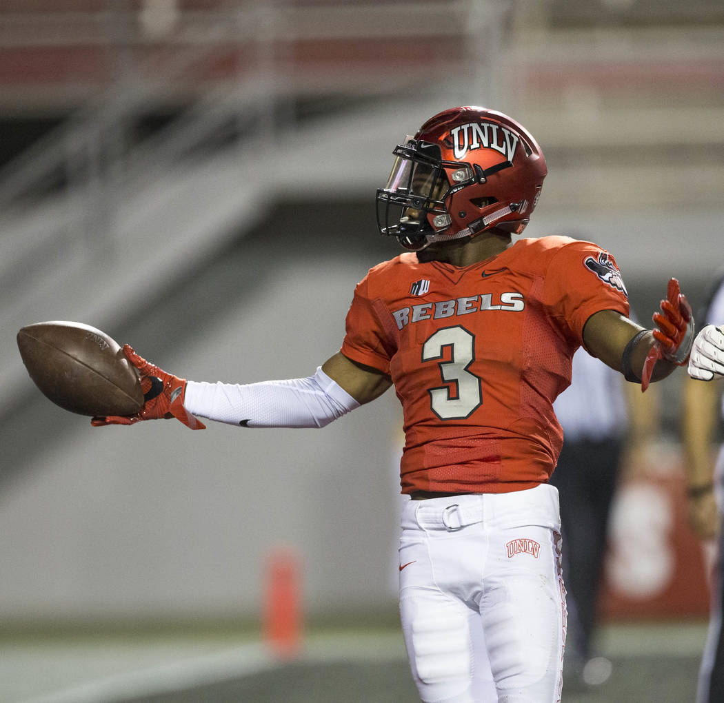 UNLV Rebels running back Lexington Thomas (3) celebrates in the end zone after scoring a touchdown during the first half of an NCAA college football game between the UNLV Rebels and the San Jose S ...