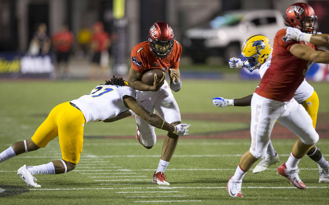 UNLV Rebels quarterback Armani Rogers (1) gets tackled by a San Jose State Spartans defender during the first half of an NCAA college football game between the UNLV Rebels and the San Jose State S ...
