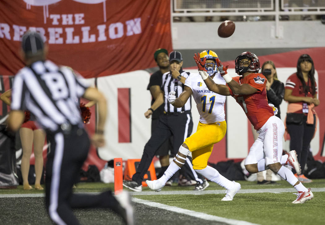 UNLV Rebels defensive back Jericho Flowers (7) intercepts a pass intended for San Jose State Spartans wide receiver JaQuan Blackwell (11) during the second half of an NCAA college football game be ...