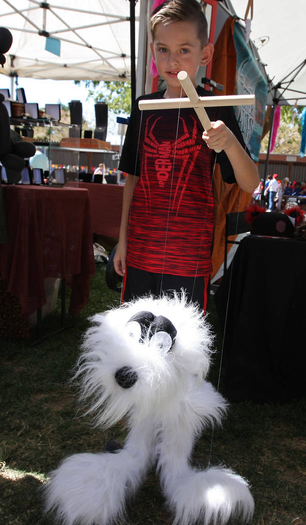 Conner Tegeda, 8, plays with a puppet during the Art in the Park festival in Boulder City, Saturday, Oct. 7, 2017. Gabriella Benavidez Las Vegas Review-Journal @latina_ish