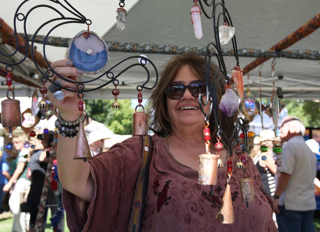 Kay Koning looks at handmade wind chimes during the Art in the Park festival in Boulder City, Saturday, Oct. 7, 2017. Gabriella Benavidez Las Vegas Review-Journal @latina_ish