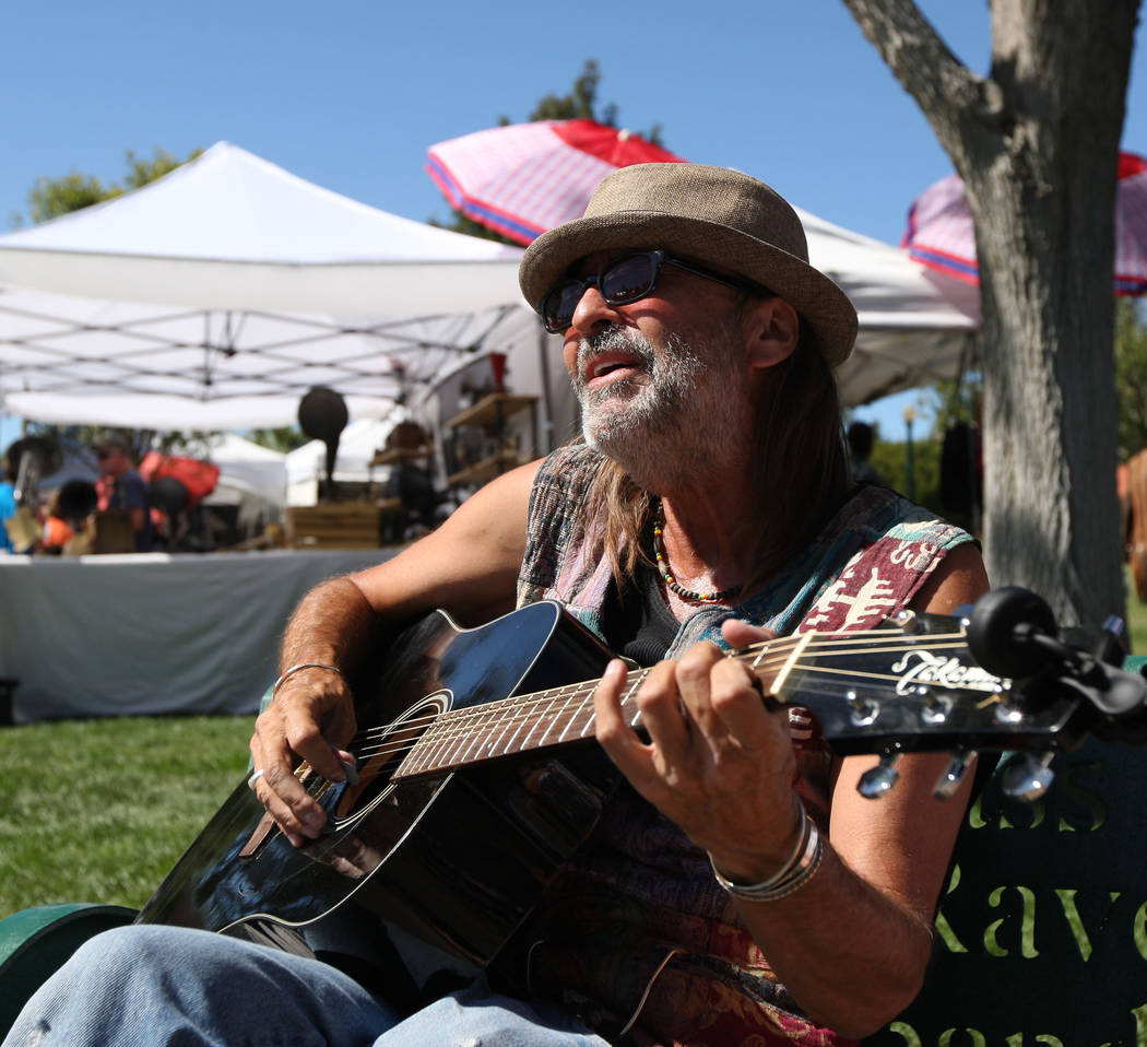 """Musician Randy White sings """"My Girl"""" by The Temptations during the Art in the Park festival in Boulder City, Saturday, Oct. 7, 2017. Gabriella Benavidez Las Vegas Review-Journal  ..."""