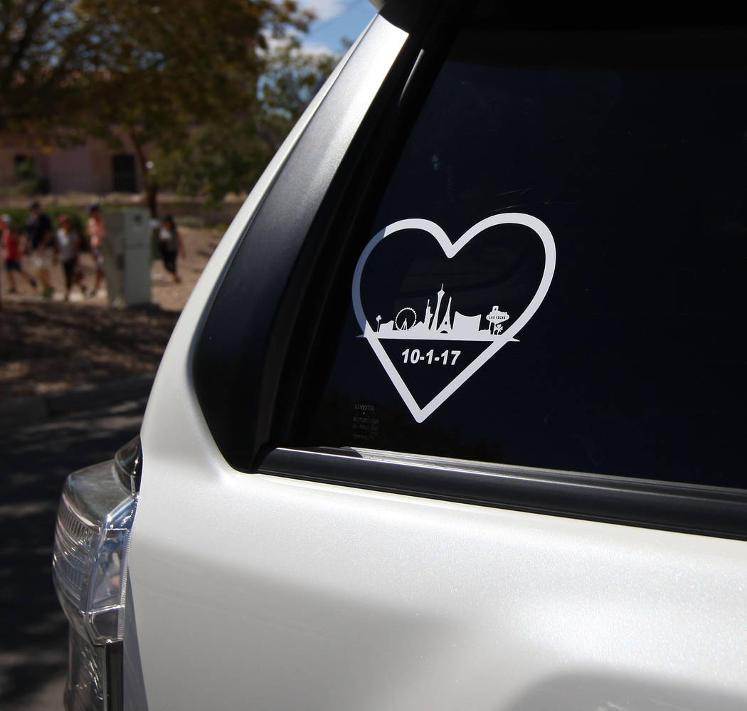A car window decal that show the Las Vegas Strip outline, as well as the date of the mass shooting that killed 58 people near the Art in the Park festival in Boulder City, Saturday, Oct. 7, 2017.  ...
